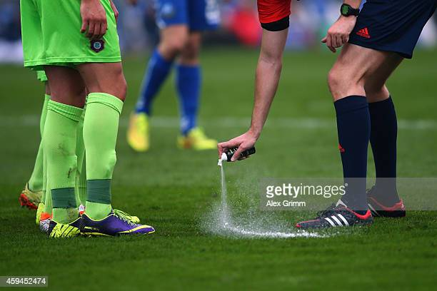 Referee Arne Aarnink uses vanishing spray during the Second Bundesliga match between Karlsruher SC and Erzgebirge Aue at Wildpark Stadium on November...