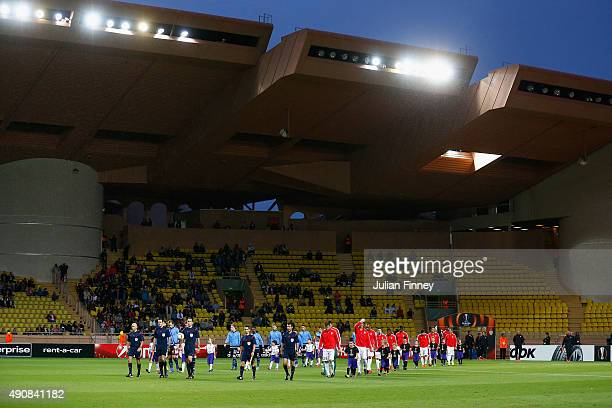 Referee Artur Dias Soares leads the teams out during the UEFA Europa League group J match between AS Monaco FC and Tottenham Hotspur FC at Stade...