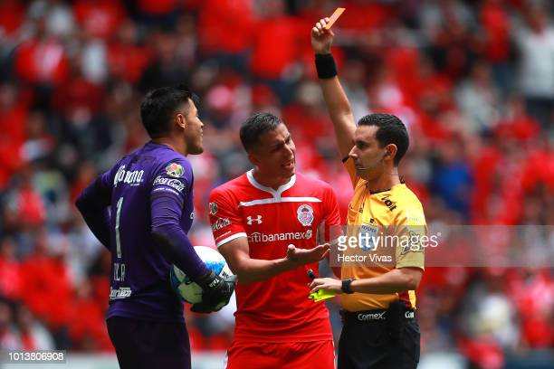 Referee Arturo Ramos shows the red card to Alfredo Talavera of Toluca during the third round match between Toluca and Chivas as part of the Torneo...
