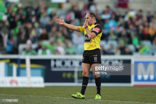 Referee Ashley Klein awards a penalty to the Sea Eagles after the try to Reuben Garrick of the Sea Eagles during the round 23 NRL match between the...