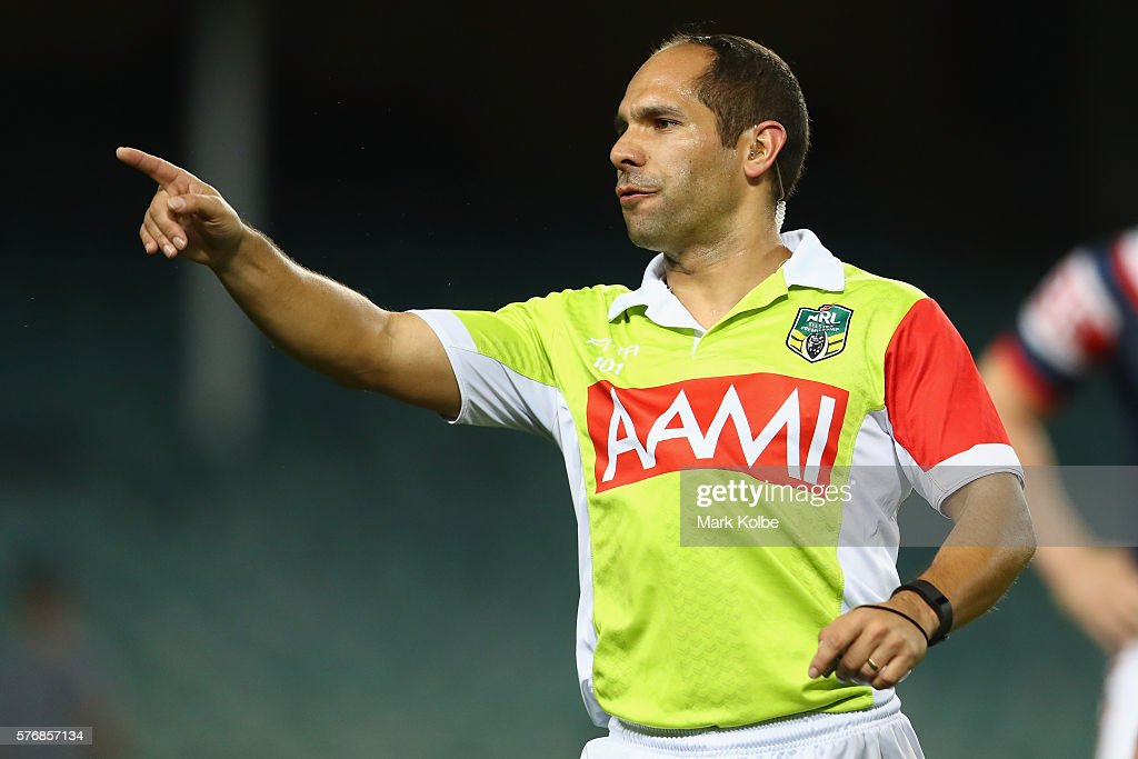 Referee Ashley Klein gestures as he makes a decision during the round 19 NRL match between the Sydney Roosters and the Cronulla Sharks at Allianz Stadium on July 18, 2016 in Sydney, Australia.