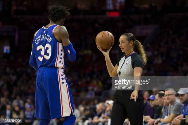 Referee Ashley MoyerGleich holds the ball for Robert Covington of the Philadelphia 76ers in the first quarter of the game against the Atlanta Hawks...
