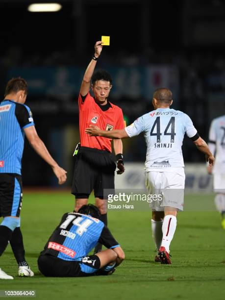 Referee Atsushi Kamimura shows an yellow card to Shinji Ono of Consadole Sapporo during the JLeague J1 match between Kawasaki Frontale and Consadole...