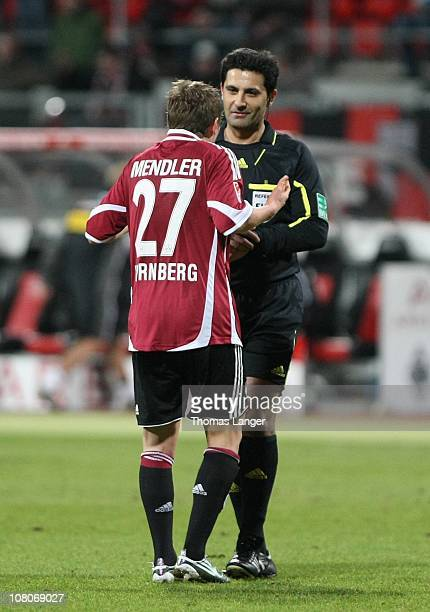 Referee Babak Rafati and Markus Mendler of Nuremberg discuss during the Bundesliga match between 1 FC Nuernberg and Borussia Moenchengladbach at the...