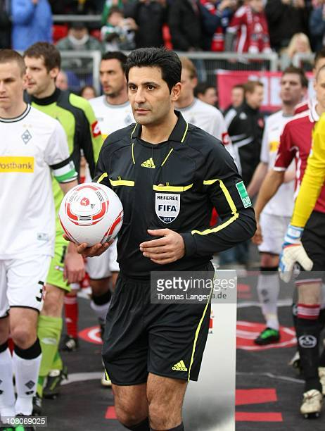 Referee Babak Rafati enters the pitch prior to the Bundesliga match between 1 FC Nuernberg and Borussia Moenchengladbach at the Easy Credit Stadium...