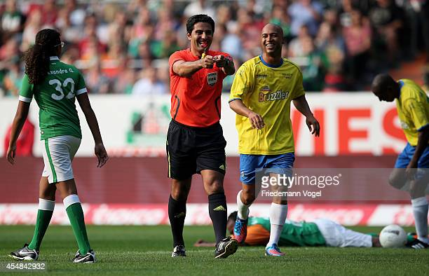 Referee Babak Rafati gives a penalty during the Ailton Farewell Match at the Weserstadion on September 6 2014 in Bremen Germany