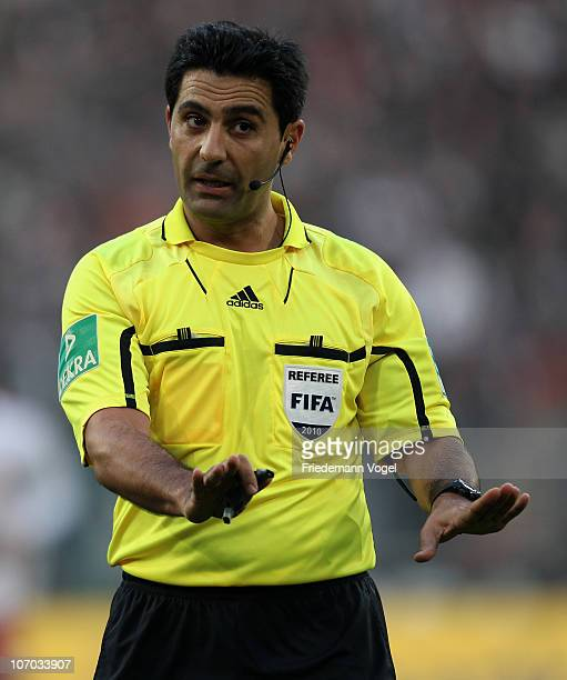 Referee Babak Rafati gives instructions during the Bundesliga match between Borussia M'gladbach and FSV Mainz 05 at Borussia Park Stadium on November...