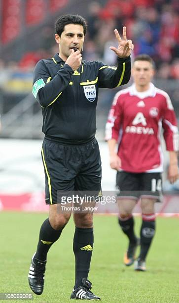 Referee Babak Rafati issues instructions during the Bundesliga match between 1 FC Nuernberg and Borussia Moenchengladbach at the Easy Credit Stadium...