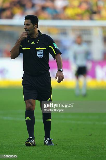 Referee Babak Rafati issues instructions during the Bundesliga match between Borussia Dortmund and FC Ausgburg at Signal Iduna Park on October 1 2011...