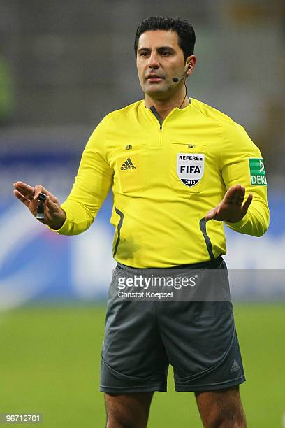 Referee Babak Rafati issues instructions during the Bundesliga match between Eintracht Frankfurt and SC Freiburg at the Commerzbank Arena on February...