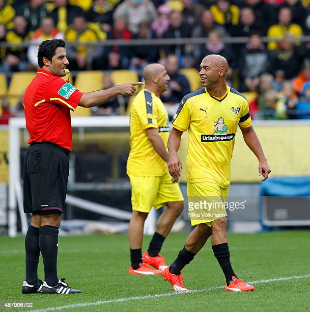 Referee Babak Rafati laughs with Dede of Dedes national team during the farewell match of Dede at Signal Iduna Park on September 5 2015 in Dortmund...