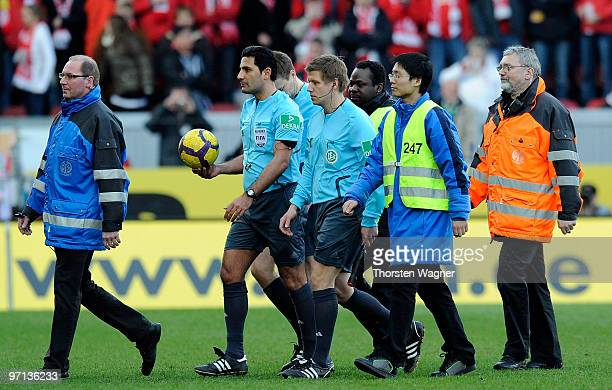 Referee Babak Rafati linesman Holger Henschel and Patrick Ittrich leaves the pitch after the Bundesliga match between FSV Mainz 05 and SV Werder...