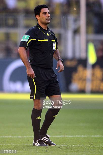 Referee Babak Rafati looks on during the Bundesliga match between Borussia Dortmund and FC Ausgburg at Signal Iduna Park on October 1 2011 in...