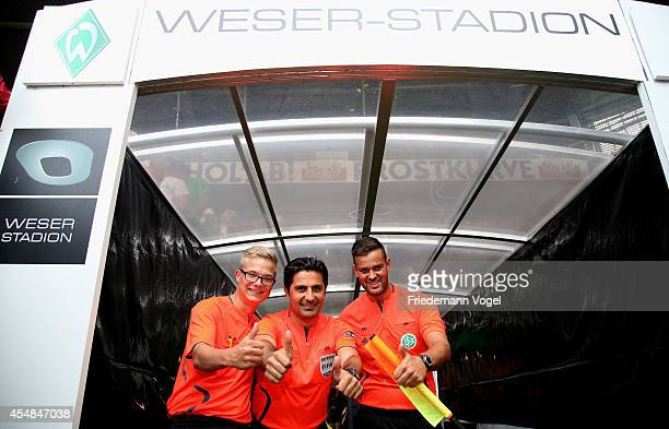 Referee Babak Rafati posese with his assistant Jan Mucke and Miguel Leite da Silva during the Ailton Farewell Match at the Weserstadion on September...