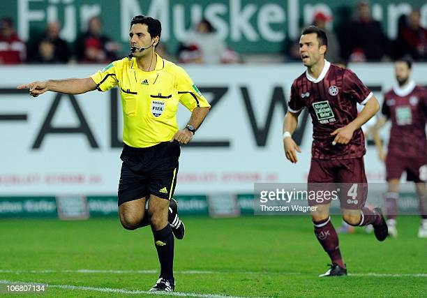 Referee Babak Rafati showes a penalty during the Bundesliga match between 1FC Kaiserslautern and VFB Stuttgart at FritzWalterStadion on November 13...