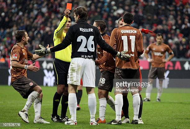 Referee Babak Rafati shows a red card to goalkeeperThomas Kessler of St Pauli during the Bundesliga match between FC Bayern Muenchen and FC St Pauli...