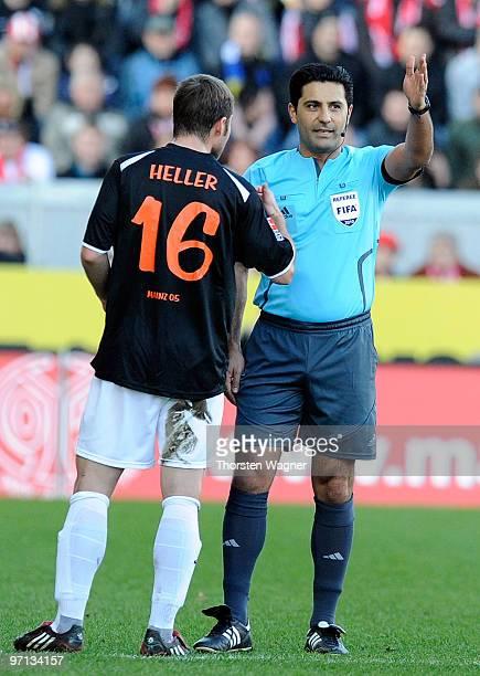 Referee Babak Rafati talks to Florian Heller of Mainz during the Bundesliga match between FSV Mainz 05 and SV Werder Bremen at Bruchweg Stadium on...