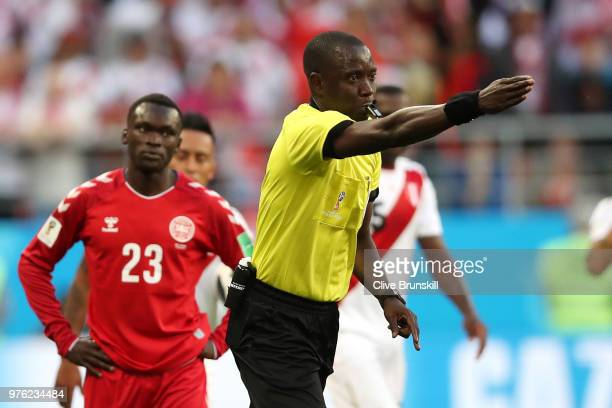 Referee Bakary Gassama awards a penalty to Peru after checking with VAR technology during the 2018 FIFA World Cup Russia group C match between Peru...