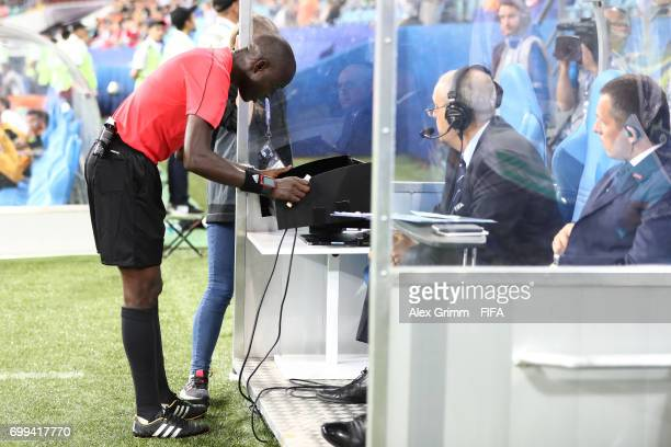 Referee Bakary Gassama reviwes footage of a mass brawl during the FIFA Confederations Cup Russia 2017 Group A match between Mexico and New Zealand at...