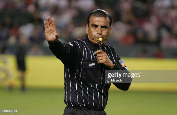 Referee Baldomero Toledo blows the final whistle to give Chivas USA the regular season Western Conference title following a scoreless draw with...