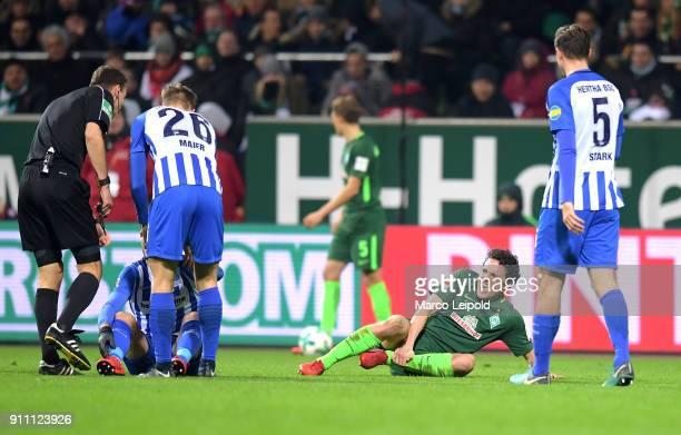 referee Bastian Dankert Arne Maier of Hertha BSC Milos Veljkovic of Werder Bremen and Niklas Stark of Hertha BSC during the game between SV Werder...