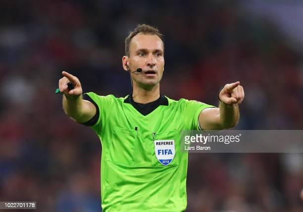 Referee Bastian Dankert makes the VAR signal during the Bundesliga match between FC Bayern Muenchen and TSG 1899 Hoffenheim at Allianz Arena on...