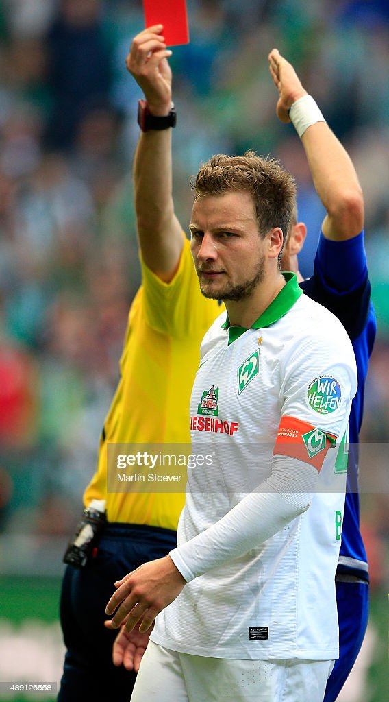 Referee Bastian Dankert shows Philipp Bargfrede of Bremen the red card during the Bundesliga match between Werder Bremen and FC Ingolstadt at Weserstadion on September 19, 2015 in Bremen, Germany.