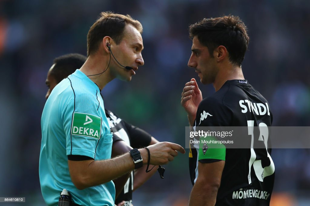 Referee, Bastian Dankert speaks to Captain, Lars Stindl of Borussia Monchengladbach during the Bundesliga match between Borussia Moenchengladbach and Bayer 04 Leverkusen at Borussia-Park on October 21, 2017 in Moenchengladbach, Germany.