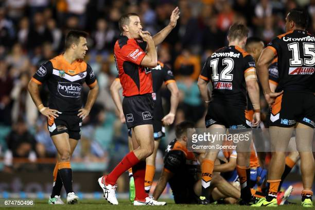 Referee Ben Cummins blows his whistle during the round nine NRL match between the Wests Tigers and the Cronulla Sharks at Leichhardt Oval on April 29...