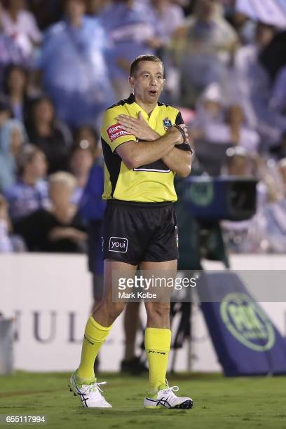 Referee Ben Cummins calls a notry as he calls for a video review during the round three NRL match between the Cronulla Sharks and the St George...