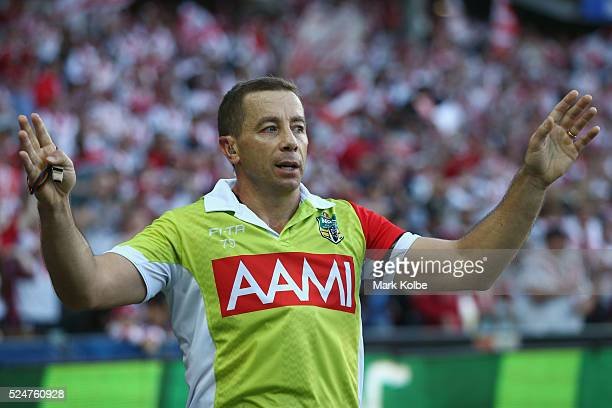 Referee Ben Cummins calls for a video review during the round eight NRL match between the St George Illawarra Dragons and the Sydney Roosters at...