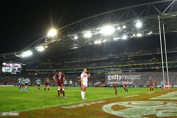 Referee Ben Cummins is seen during game one of the State Of Origin series between the New South Wales Blues and the Queensland Maroons at ANZ Stadium...