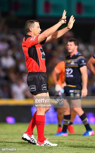 Referee Ben Cummins sends Clay Priest of the Raiders to the sin bin during the round one NRL match between the North Queensland Cowboys and the...