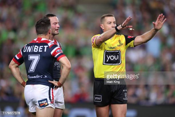 Referee Ben Cummins sends Cooper Cronk of the Roosters to the sinbin is tackled during the 2019 NRL Grand Final match between the Canberra Raiders...