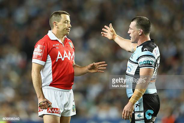 Referee Ben Cummins speaks to Paul Gallen of the Sharks during the NRL Preliminary Final match between the Cronulla Sharks and the North Queensland...