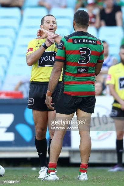 Referee Ben Cummins talks to Greg Inglis of the Rabbitohs during the round four AFL match between the South Sydney Rabbitohs and the Canterbury...