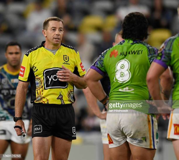 Referee Ben Cummins talks to Josh Papalii of the Raiders before placing him on report during the round 12 NRL match between the North Queensland...
