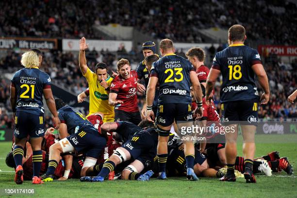 Referee Ben O'Keeffe awards a try to the Crusaders during the round one Super Rugby Aotearoa match between the Highlanders and the Crusaders at...