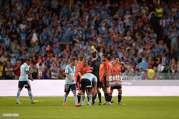 Referee Ben Williams gives a yellow card during the round 12 ALeague match between Sydney FC and Brisbane Roar at Allianz Stadium on December 26 2013...