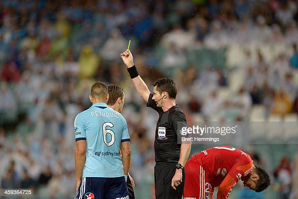 Referee Ben Williams gives a yellow card to Nikola Petkovic of Sydney during the round 12 ALeague match between Sydney FC and Brisbane Roar at...