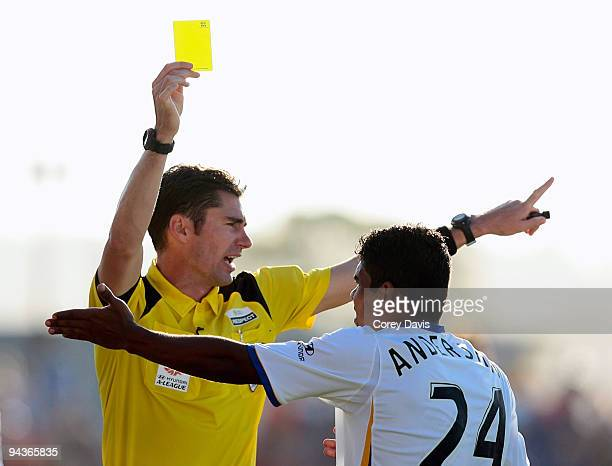 Referee Ben Williams issues United player Anderson Alves Da Silva a yellow card during the round 18 ALeague match between the Newcastle Jets and Gold...