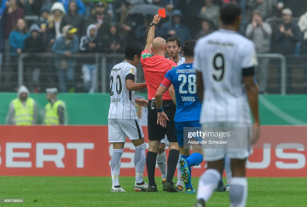 Referee Benedikt Kempkes shows David Angel Abraham of Eintracht Frankfurt the red card during the DFB Cup match between TuS Erndtebrueck and Eintracht Frankfurt at Leimbachstadion on August 12, 2017 in Siegen, Germany.