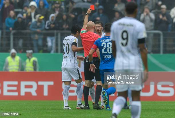 Referee Benedikt Kempkes shows David Angel Abraham of Eintracht Frankfurt the red card during the DFB Cup match between TuS Erndtebrueck and...