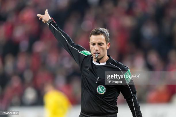 Referee Benjamin Brand gestures during the Bundesliga match between 1 FSV Mainz 05 and Borussia Dortmund at Opel Arena on December 12 2017 in Mainz...
