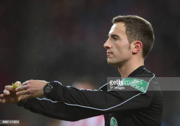 Referee Benjamin Brand gestures during the Bundesliga match between 1 FC Koeln and VfL Wolfsburg at RheinEnergieStadion on December 16 2017 in...
