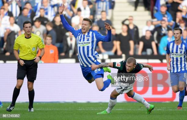 referee Benjamin Brand Mitchell Weiser of Hertha BSC and Max Meyer of FC Schalke 04 during the game between Hertha BSC and Schalke 04 on october 14...