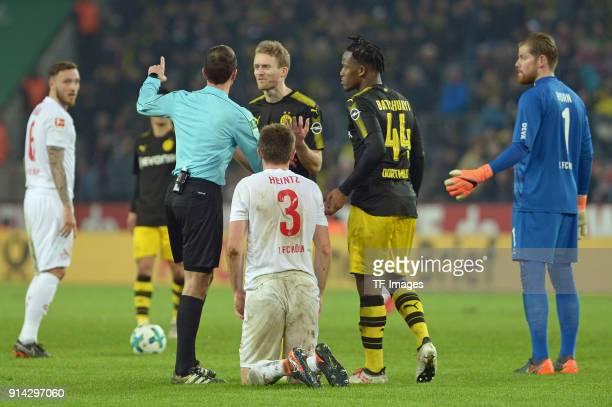 Referee Benjamin Brand speaks with Andre Schuerrle of Dortmund during the Bundesliga match between 1 FC Koeln and Borussia Dortmund at...
