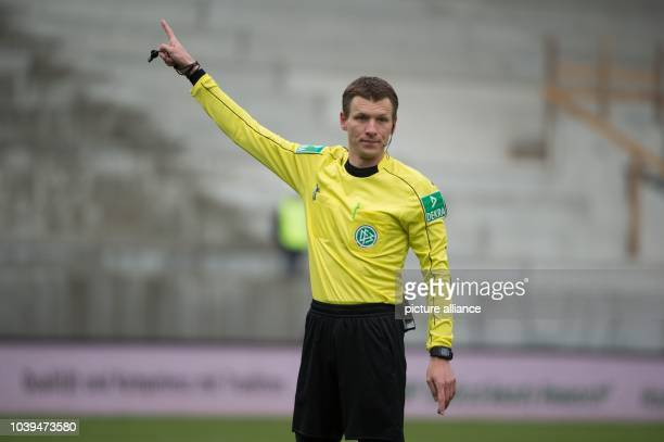 Referee Benjamin Cortus gestures during the German 2nd divisionBundesliga soccer match between Erzgebirge Aue and Hannover 96 in the...