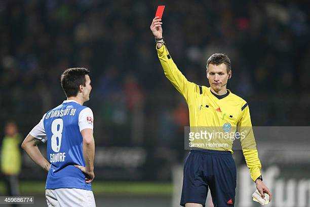 Referee Benjamin Cortus shows the red card to Jerome Gondorf of Darmstadt during the Second Bundesliga match between SV Darmstadt 98 and Karlsruher...
