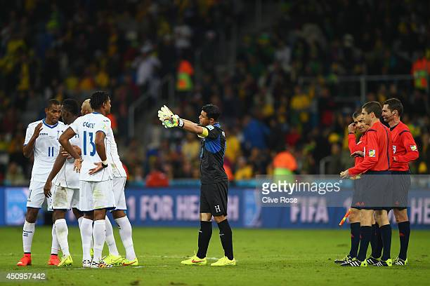 Referee Benjamin Williams and assistant referees look on as Honduras appeal a call at the half during the 2014 FIFA World Cup Brazil Group E match...